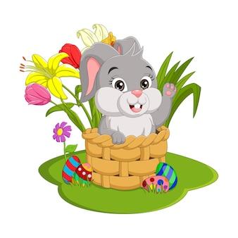 행복한 부활절 날. 바구니에 앉아 귀여운 부활절 토끼