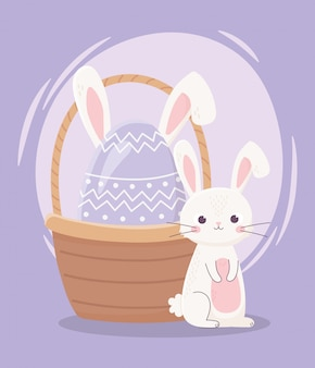 ハッピーイースターの日、かわいいウサギと卵のバスケットに耳を持つ