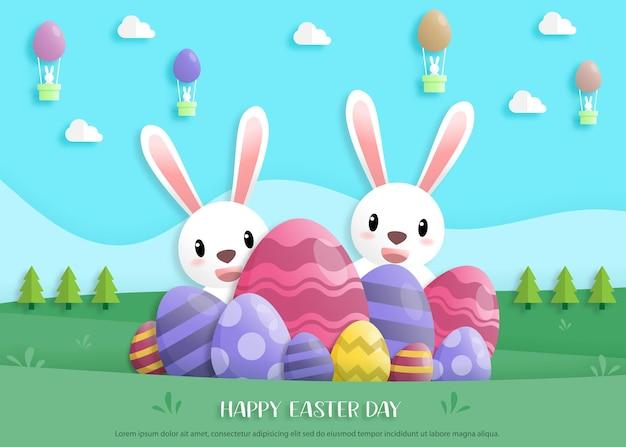 ウサギとイースターエッグとペーパーアートスタイルでハッピーイースターの日。グリーティングカード