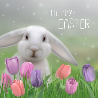 ハッピーイースターグリーティングカード。草や繊細なチューリップに座っているウサギを食べる。