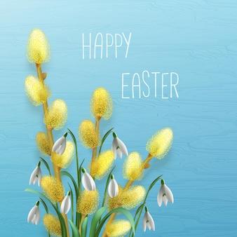 Поздравительная открытка счастливой пасхи с подснежниками и цветущими ветвями ивы.