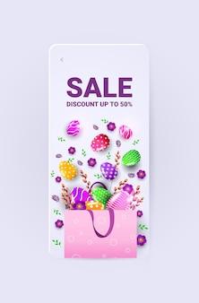 幸せなイースターの休日のお祝いの販売バナーチラシまたは装飾的な卵と花の縦のイラストとグリーティングカード