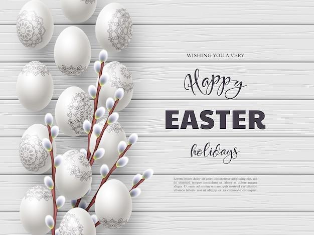 Счастливый состав праздника пасхи с пасхальными яйцами и ветвями вербы на белом деревянном.