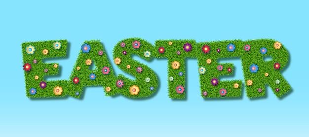 草の質感と紙で作られた花とハッピーイースターのレタリング