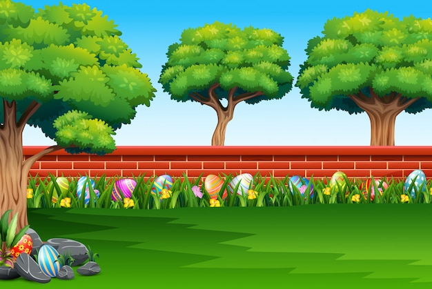 Happy easter on the nature with a brick fence background