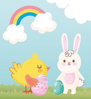 Happy easter, rabbit and chicken with eggs in grass rainbow clouds
