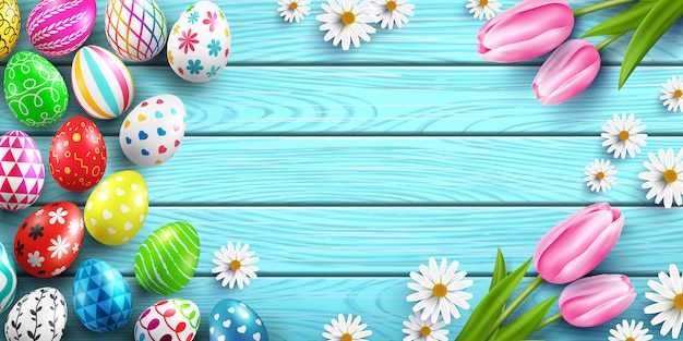 Happy easter  template with colorful easter eggs and flower on wood table