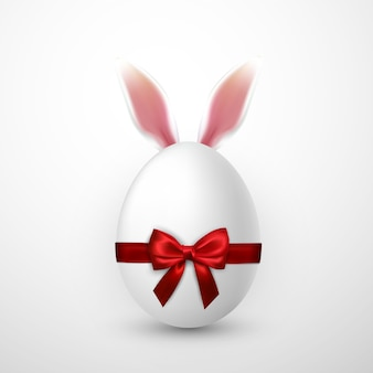 Happy easter with easter egg with red bow and easter bunny ears