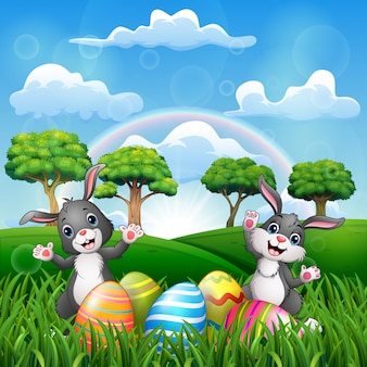 Happy easter with two bunnies on the nature
