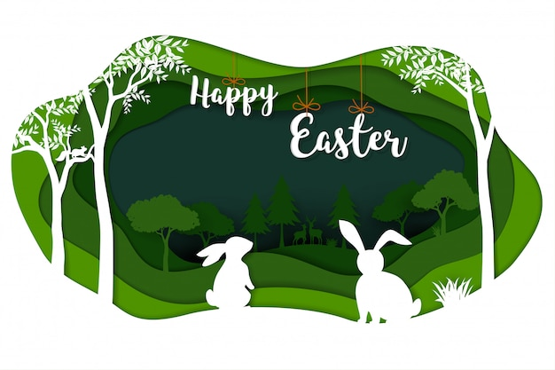 Happy easter with white rabbits on green nature