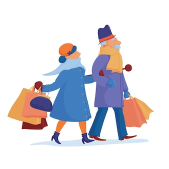 Happy elder couple, man and woman, in warm clothes going home from winter sale, shopping, carrying many shopping bags and purchases