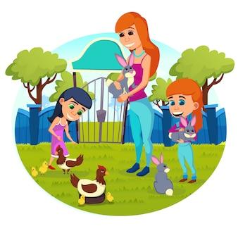 Счастливая семья ласкает и кормит животных в зоопарке