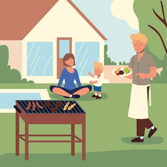 Happy family cooking backyard