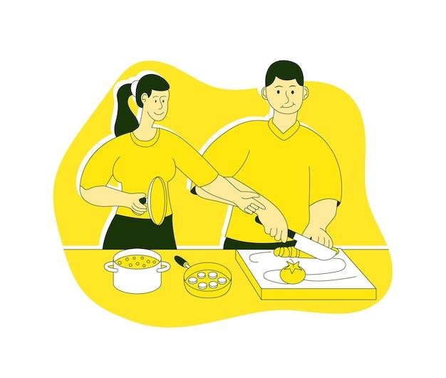 幸せな家族のカップルが家庭の台所で一緒に料理を作る