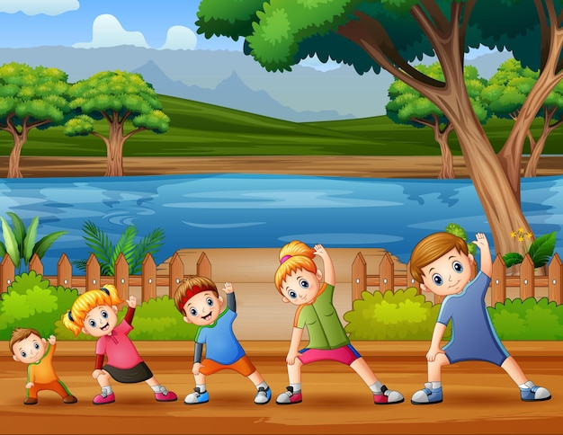 Happy family doing exercise in the riverside