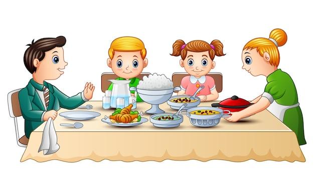 Cute little boy cartoon eating on dining table | Premium ...