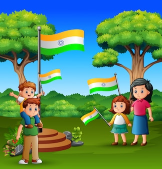 Happy family holding national flag on the nature