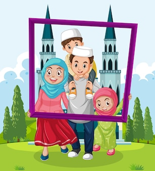 Happy family holding photo frame with mosque on the background