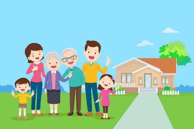 彼の家の背景に幸せな家族。公園で一緒に大家族