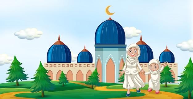 Счастливая семья перед мечетью