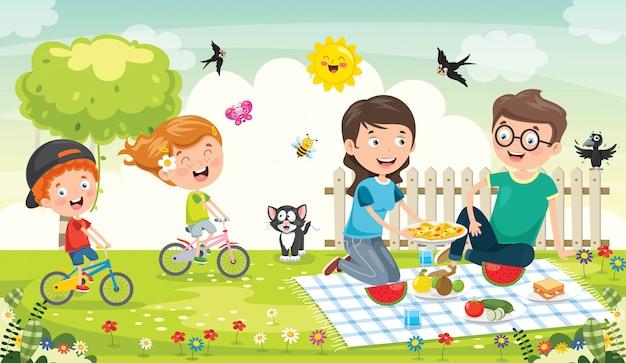 自然でピクニックを作る幸せな家族