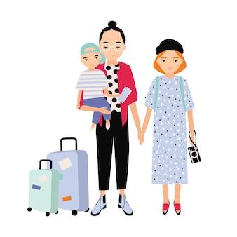 旅行で幸せな家族。母親、父親、赤ちゃんの息子が一緒に旅行