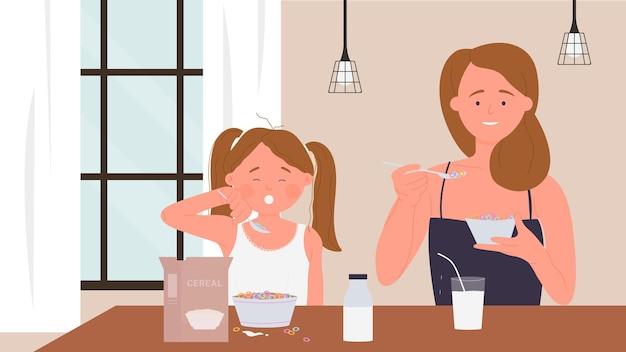 幸せな家族の人々は朝の食事を食べる朝食の食べ物面白い母娘娘を食べる