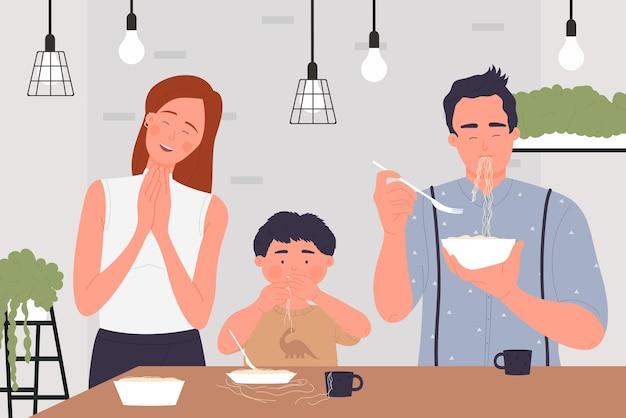 Счастливые семейные люди едят макароны, спагетти или лапшу, милая семейная домашняя сцена на кухне