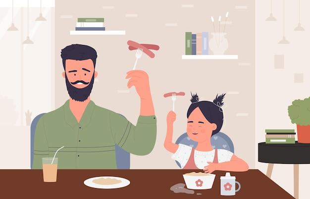 Счастливая семья, люди едят сосиски, молодой смешной отец, милая девочка, ребенок, весело проводят время вместе