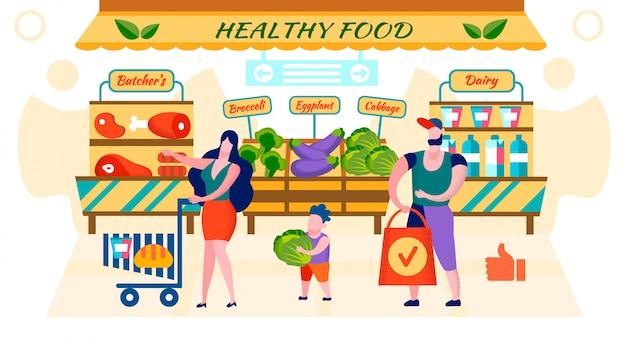 幸せな家族の市場で新鮮な健康食品をショッピング