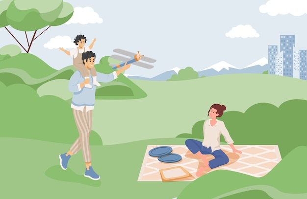 Happy family spending time together at summer picnic