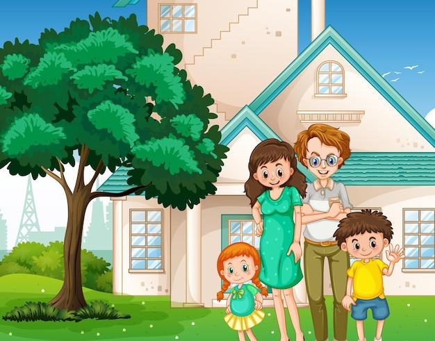 家の前に立っている幸せな家族