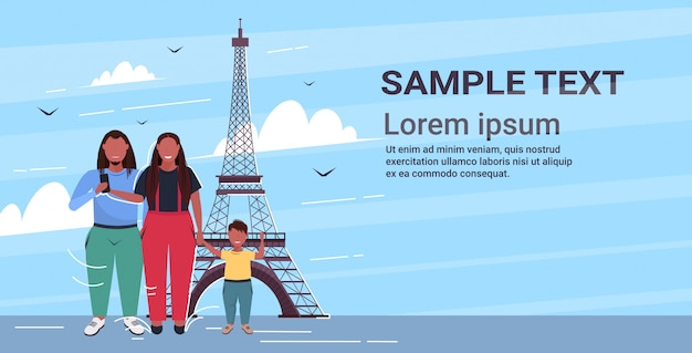 Happy family standing together mother her and son having fun travel concept paris abstract city silhouette background  full length copy space horizontal