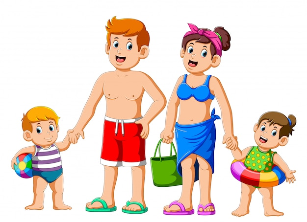 Happy family on summer vacation going to the beach
