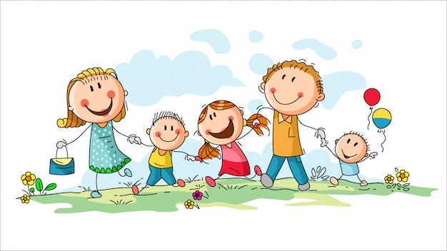 Happy family with tree children having fun running outdoors