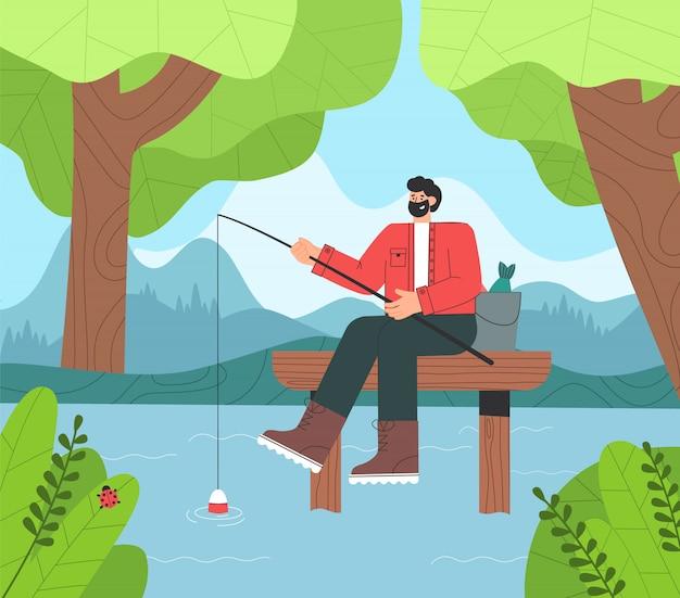 Счастливый рыболов сидя на деревянном мосте с штангой и ведром.