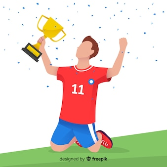 Happy football player winning a trophy