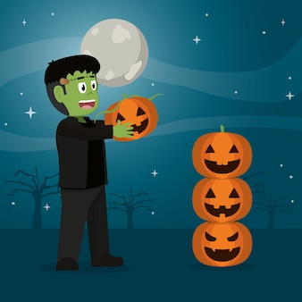 Happy frankenstein monster with funny pumpkin