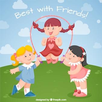 Счастливые друзья играют с скакалка
