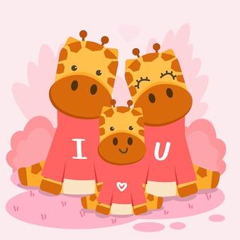 Famiglia felice della giraffa che posa insieme al testo ti amo