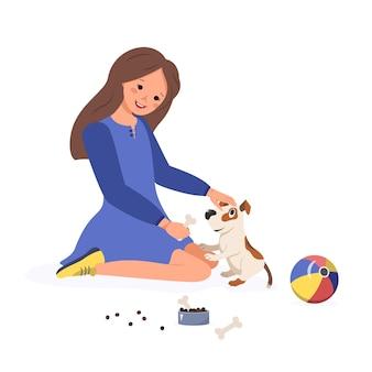 幸せな女の子は子犬に骨を与えます。子供は犬と遊ぶ。飼い主がペットの世話をします。ベクトルフラットイラスト