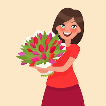 Happy girl holding a bouquet of flowers. congratulations on the 8th of march women's day or birthday.