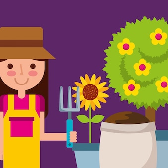 Happy girl holding rake pot sunflower tree and sack soil garden