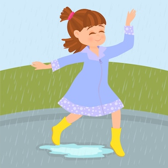 A happy girl plays in the rain