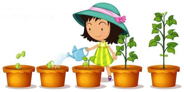 白い背景の上の植物に水をまく幸せな女の子