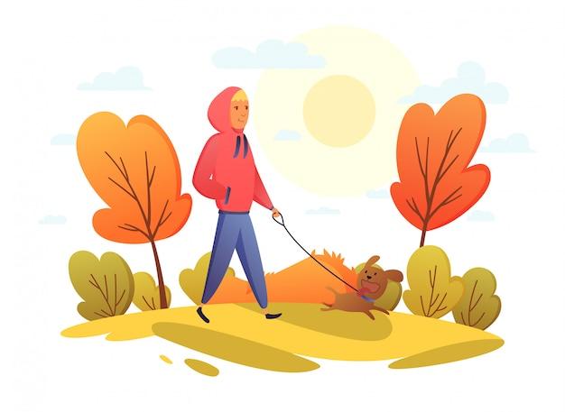 秋の公園で犬と一緒に幸せな女の子。トレンドカラー。漫画フラットスタイルのベクトル図。