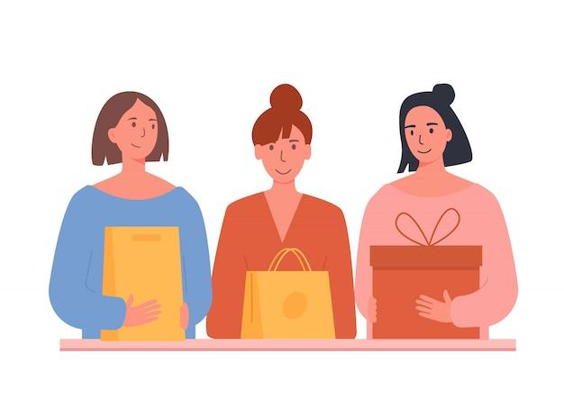 행복한 여자 친구가 배달을 받았습니다. 쇼핑백과 상자 여자입니다.