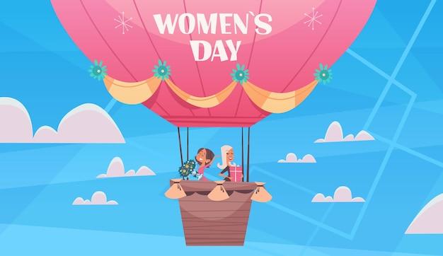 뜨거운 공기 풍선 여성의 날 3 월 8 일 휴가 축 하 개념 배너 전단지 또는 인사말 카드 가로 그림에서 비행하는 행복 한 여자