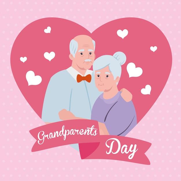 かわいい古いカップルと心の装飾と幸せな祖父母の日