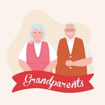 かわいい古いカップルとリボンの装飾と幸せな祖父母の日